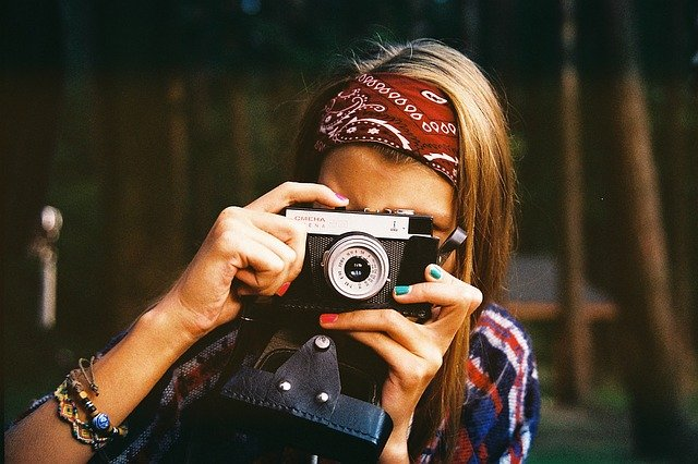 woman camera photographer hobby